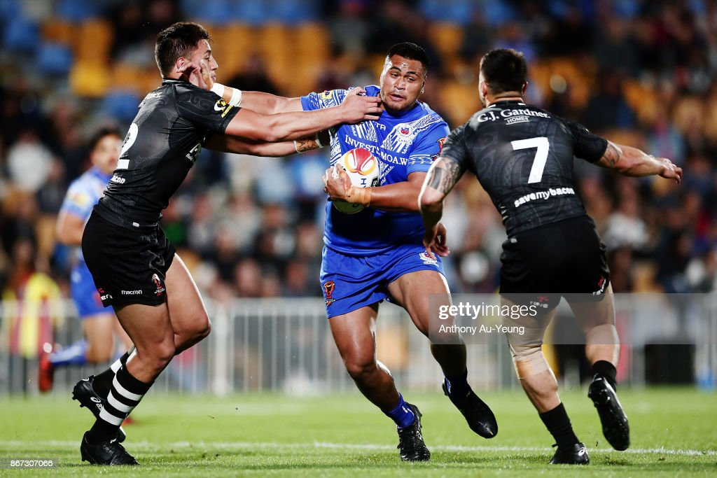 Sam Lisone of Samoa on the charge against Joseph Tapine and Shaun Johnson of the Kiwis during the 2017 Rugby League World Cup match between the New Zealand Kiwis and Samoa at Mt Smart Stadium on October 28, 2017 in Auckland, New Zealand.