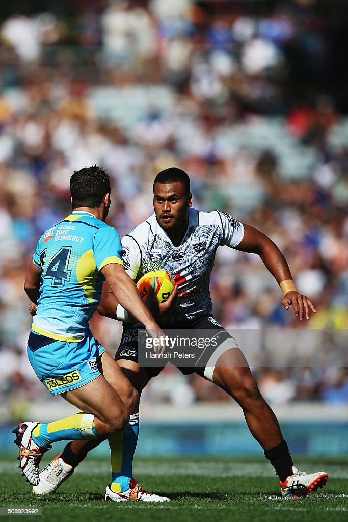 Sam Lisone of the Warriors charges forward during the 2016 Auckland Nines semi final match between the New Zealand Warriors and the Gold Coast Titans at Eden Park on February 7, 2016 in Auckland, New Zealand.