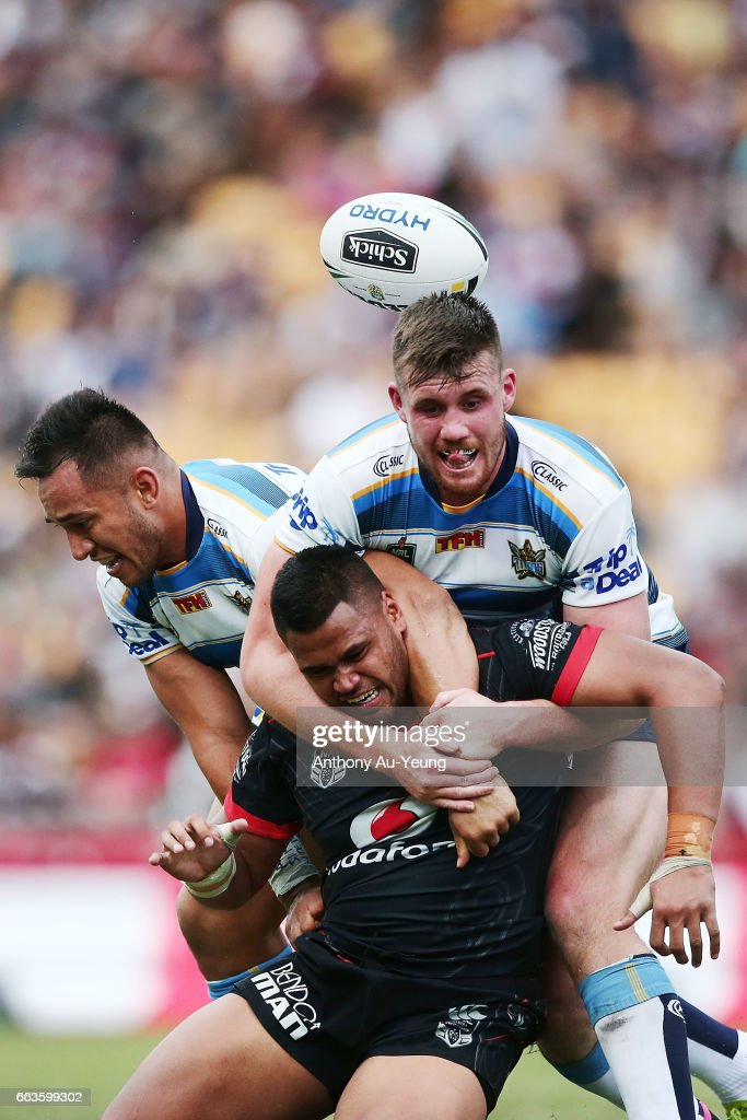 Sam Lisone of the Warriors loses the ball in the tackle from Joe Greenwood of the Titans during the round five NRL match between the New Zealand Warriors and the Gold Coast Titans at Mt Smart Stadium on April 2, 2017 in Auckland, New Zealand.
