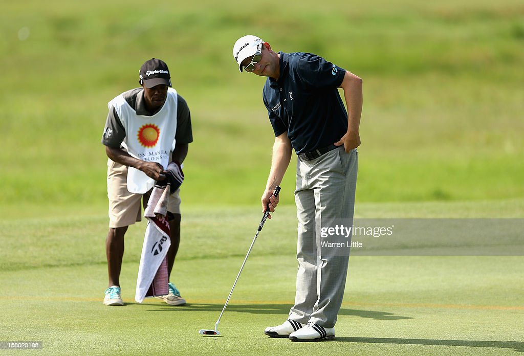 Sam Little of England prepares to putt on the 12th green during the second round of The Nelson Mandela Championship presented by ISPS Handa at Royal Durban Golf Club on December 9, 2012 in Durban, South Africa.