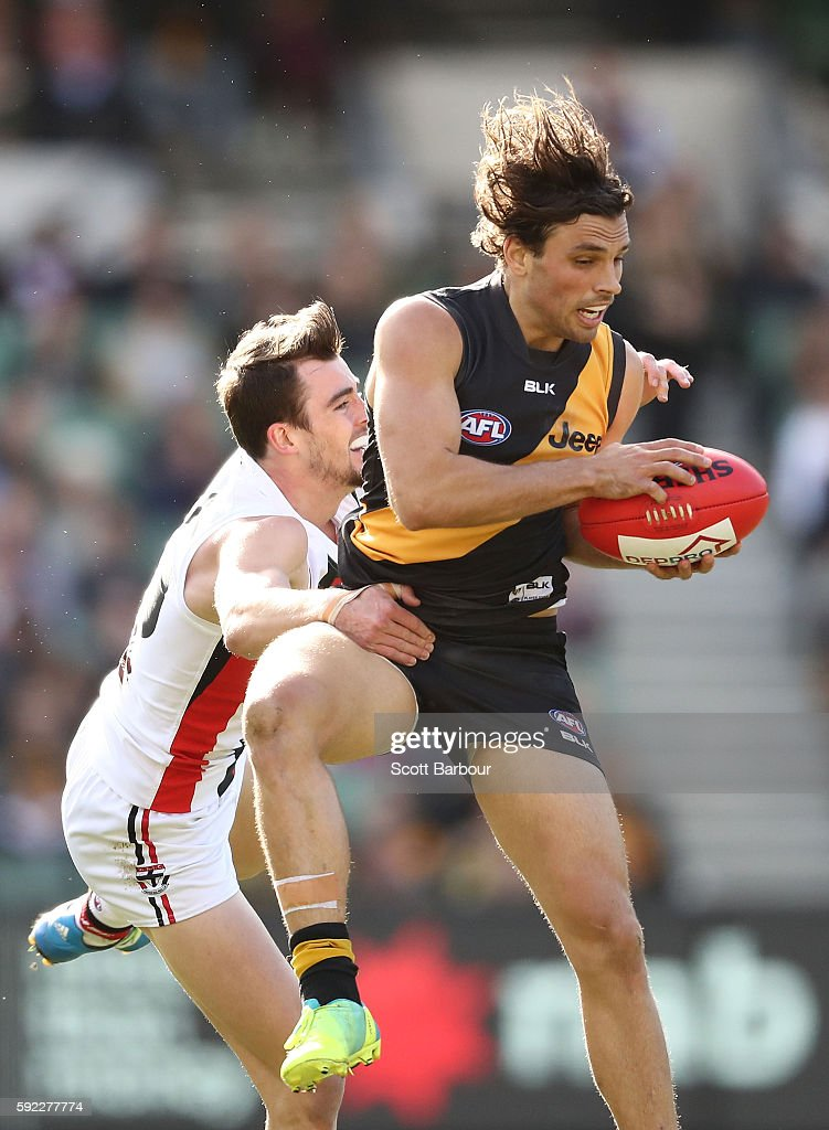 Sam Lloyd of the Tigers and Daniel McKenzie of the Saints compete for the ball during the round 22 AFL match between the Richmond Tigers and the St...