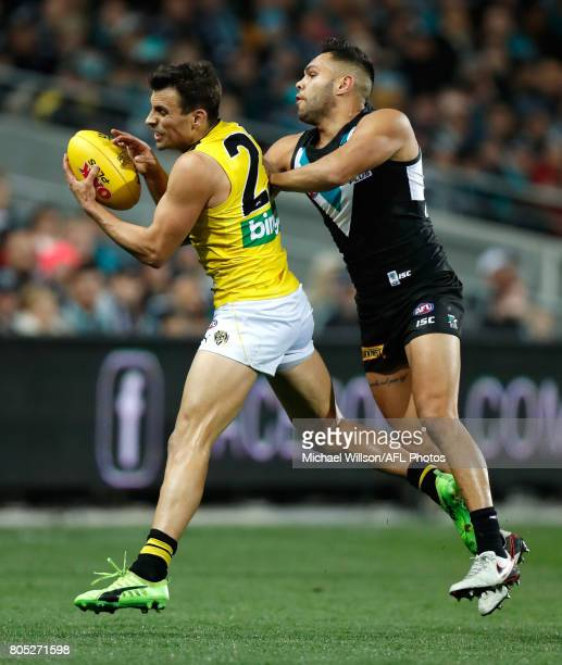 Sam Lloyd of the Tigers and Jarman Impey of the Power compete for the ball during the 2017 AFL round 15 match between the Port Adelaide Power and the...
