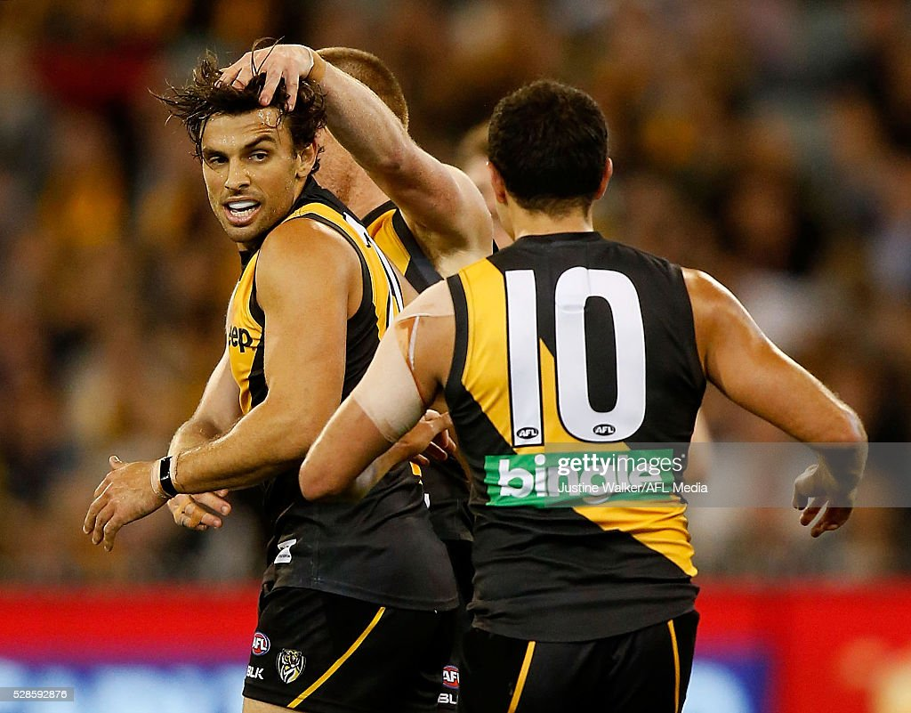 Sam Lloyd of the Tigers celebrates a goal during the 2016 AFL Round 07 match between the Richmond Tigers and the Hawthorn Hawks at the Melbourne Cricket Ground, Melbourne on May 6, 2016.