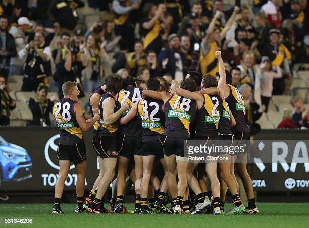 Sam Lloyd of the Tigers celebrates with team mates after scoring a goal after the siren during the round eight AFL match between the Richmond Tigers...