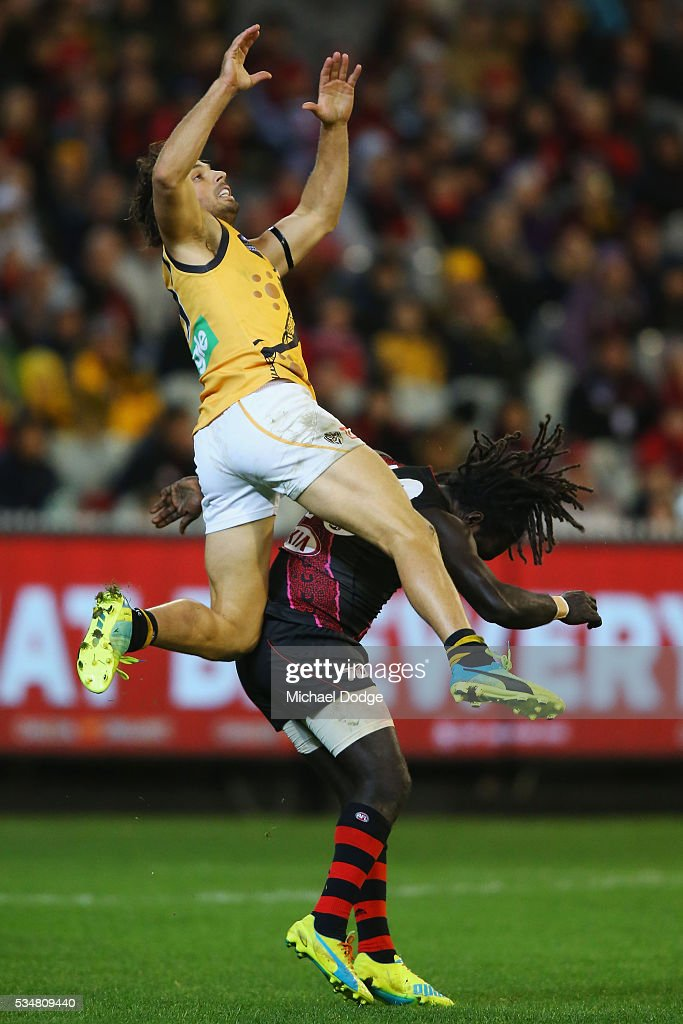 Sam Lloyd of the Tigers competes for the ball over Anthony McDonald-Tipungwuti of the Bombers during the round 10 AFL match between the Essendon Bombers and the Richmond Tigers at Melbourne Cricket Ground on May 28, 2016 in Melbourne, Australia.