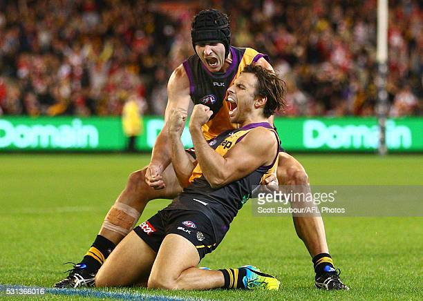 Sam Lloyd of the Tigers is congratulated by Ben Griffiths of the Tigers after kicking the matchwinning goal after the final siren during the round...