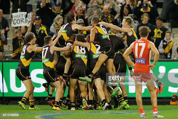 Sam Lloyd of the Tigers is swamped by team mates after kicking the winning goal during the round eight AFL match between the Richmond Tigers and the...