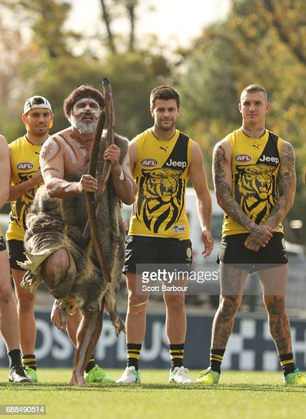 Sam Lloyd Trent Cotchin and Dustin Martin of the Tigers look on as participants of the club's Korin Gamadji Institute perform a preview of the Tigers...