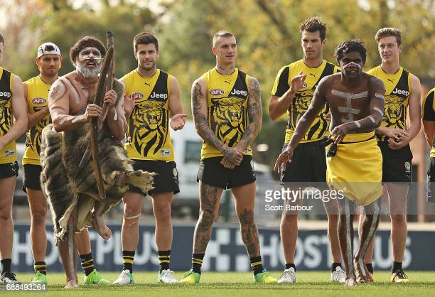 Sam Lloyd Trent Cotchin Dustin Martin and Alex Rance of the Tigers look on as participants of the club's Korin Gamadji Institute perform a preview of...