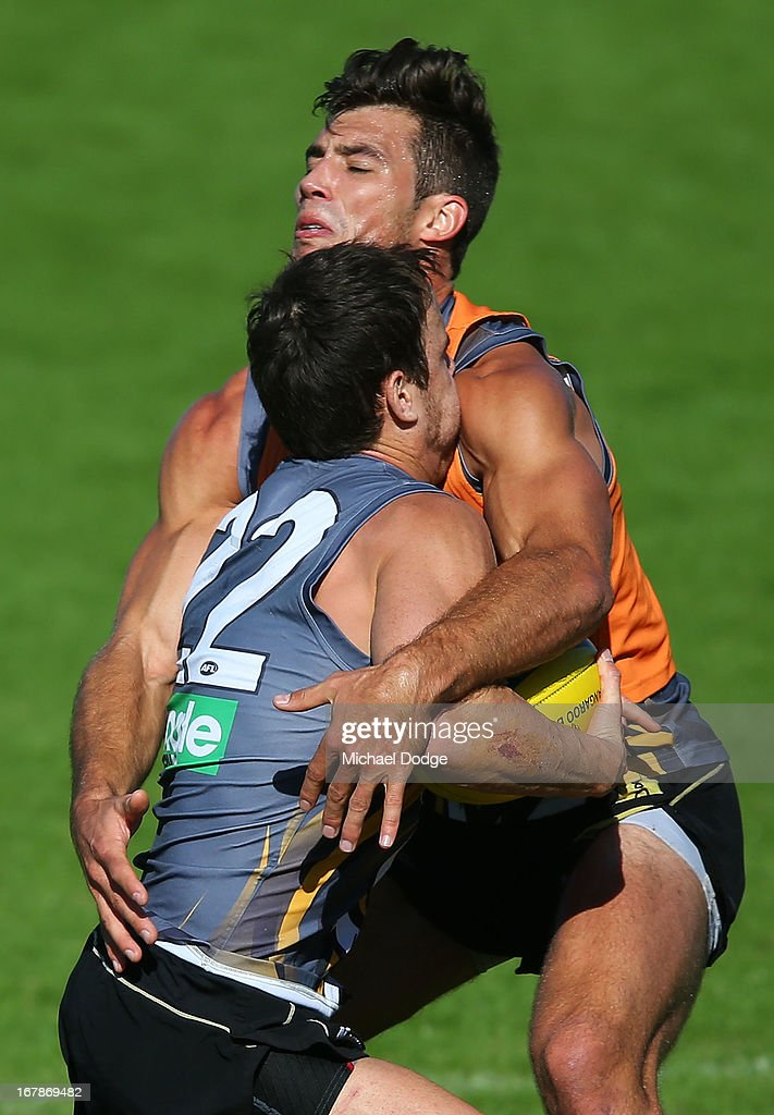 Sam Lonergan gets tackled by Alex Rance during a Richmond Tigers AFL training session at ME Bank Centre on May 2, 2013 in Melbourne, Australia.