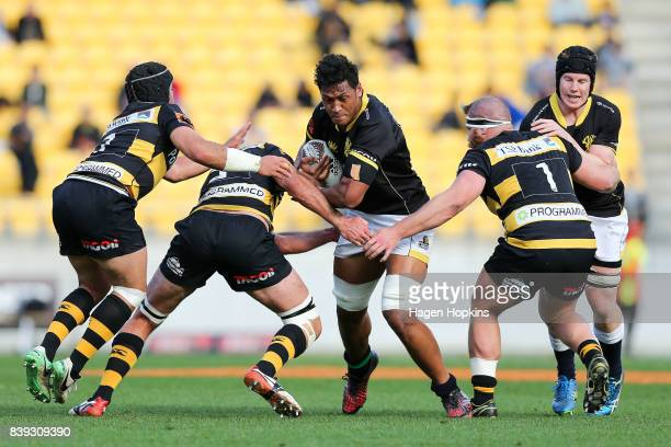 Sam Lousi of Wellington is tackled during the round two Mitre 10 Cup match between Wellington and Taranaki at Westpac Stadium on August 26 2017 in...