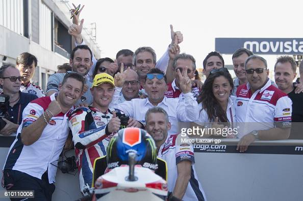 Sam Lowes of Britain and Feder Oil Gresini Moto2 celebrates with team the pole position at the end of the qualifying practice during the MotoGP of...