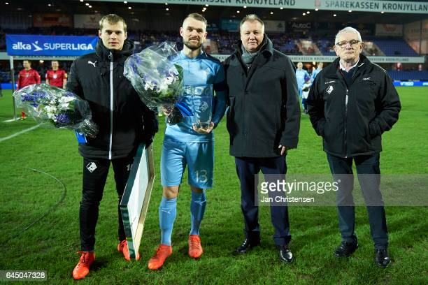 Sam Lundholm of Randers FC and Mads Fenger of Randers FC receives flowers prior to the Danish Alka Superliga match between Randers FC and FC...