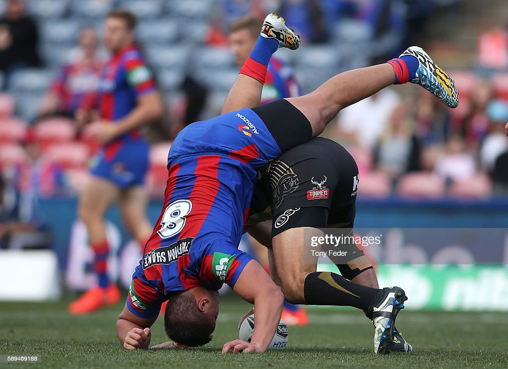 Sam Mataora of the Knights is upended by a Panthers player during the round 23 NRL match between the Newcastle Knights and the Penrith Panthers at Hunter Stadium on August 14, 2016 in Newcastle, Australia.