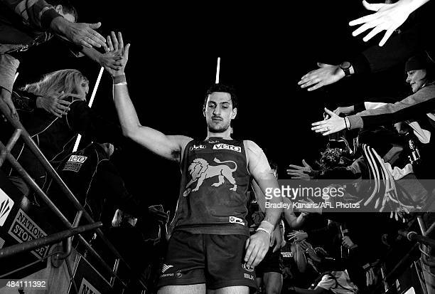 Sam Mayes of the Lions celebrates victory with fans after the round 20 AFL match between the Brisbane Lions and the Carlton Blues at The Gabba on...