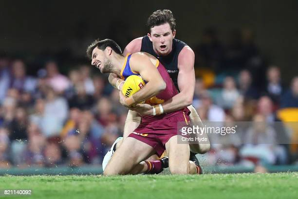 Sam Mayes of the Lions is tackled by Jed Lamb of the Blues during the round 18 AFL match between the Brisbane Lions and the Carlton Blues at The...
