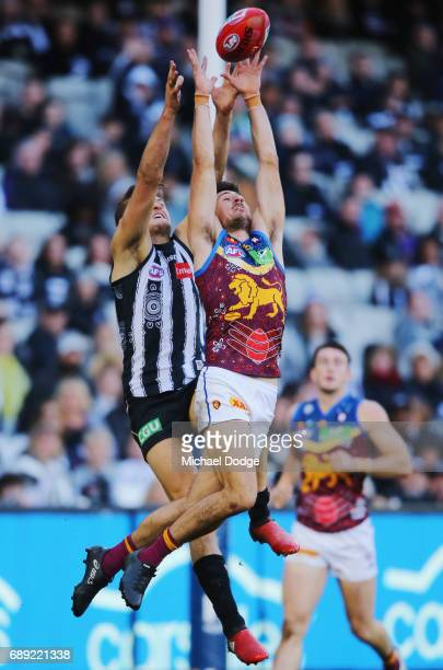 Sam Mayes of the Lions marks the ball against Darcy Moore of the Magpies during the round 10 AFL match between the Collingwood Magpies and Brisbane...