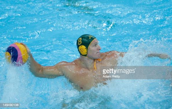 Sam McGregor of Australia throws in the Men's Water Polo Preliminary Round Group A match between Australia and Italy on Day 2 of the London 2012...