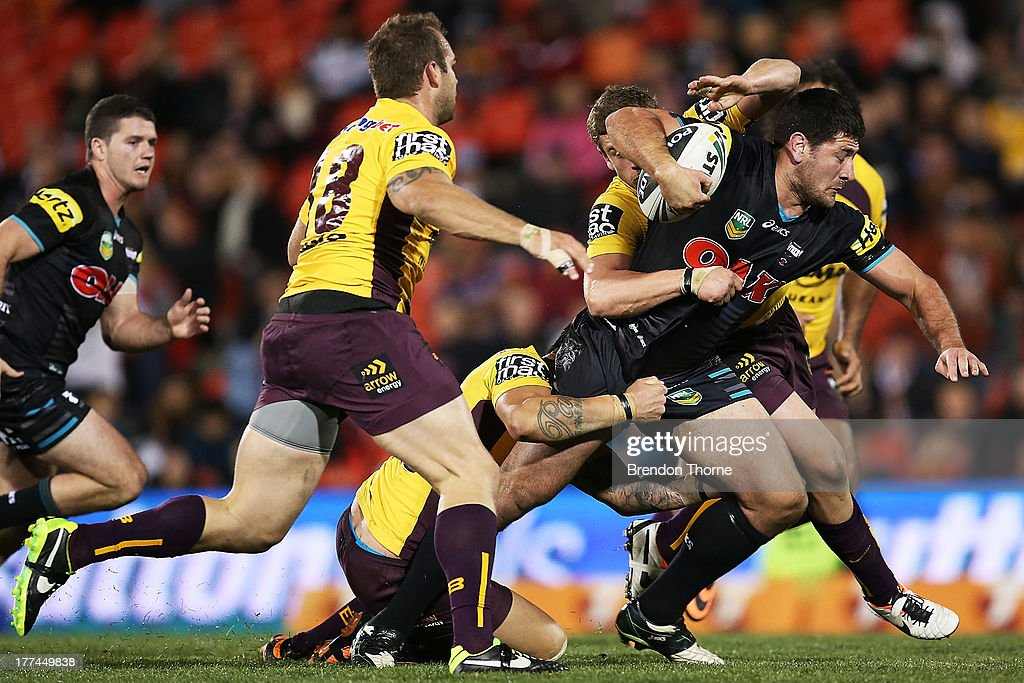 Sam McKendry of the Panthers is tackled by the Broncos defence during the round 24 NRL match between the Penrith Panthers and the Brisbane Broncos at Centrebet Stadium on August 23, 2013 in Sydney, Australia.