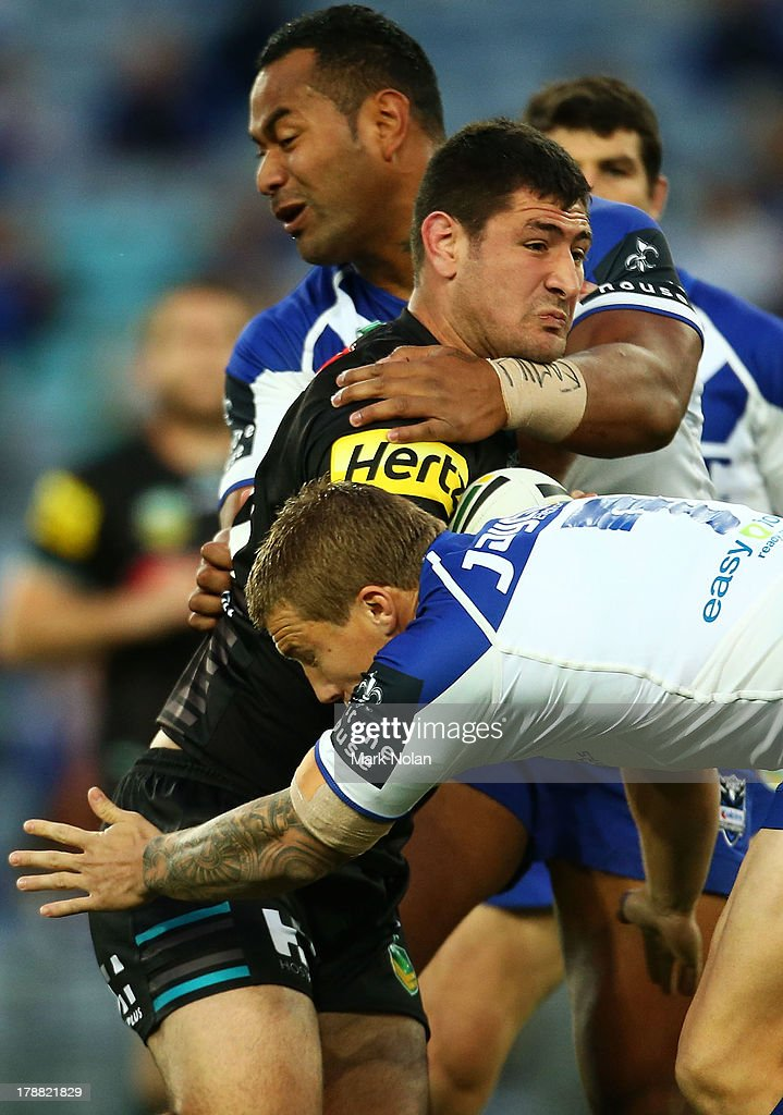 Sam McKendry of the Panthers is tackled during the round 25 NRL match between the Canterbury Bulldogs and the Penrith Panthers at ANZ Stadium on August 31, 2013 in Sydney, Australia.