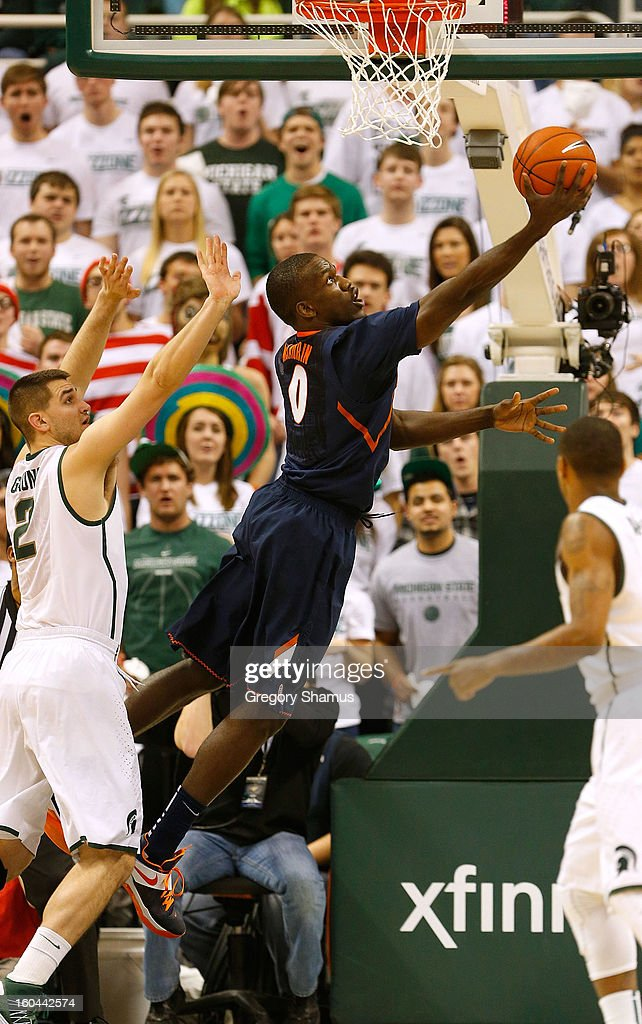 Sam McLaurin #0 of the Illinois Fighting Illini gets to the basket past Alex Gauna #2 of the Michigan State Spartans during the first half at the Jack T. Breslin Student Events Center on January 31, 2013 in East Lansing, Michigan.
