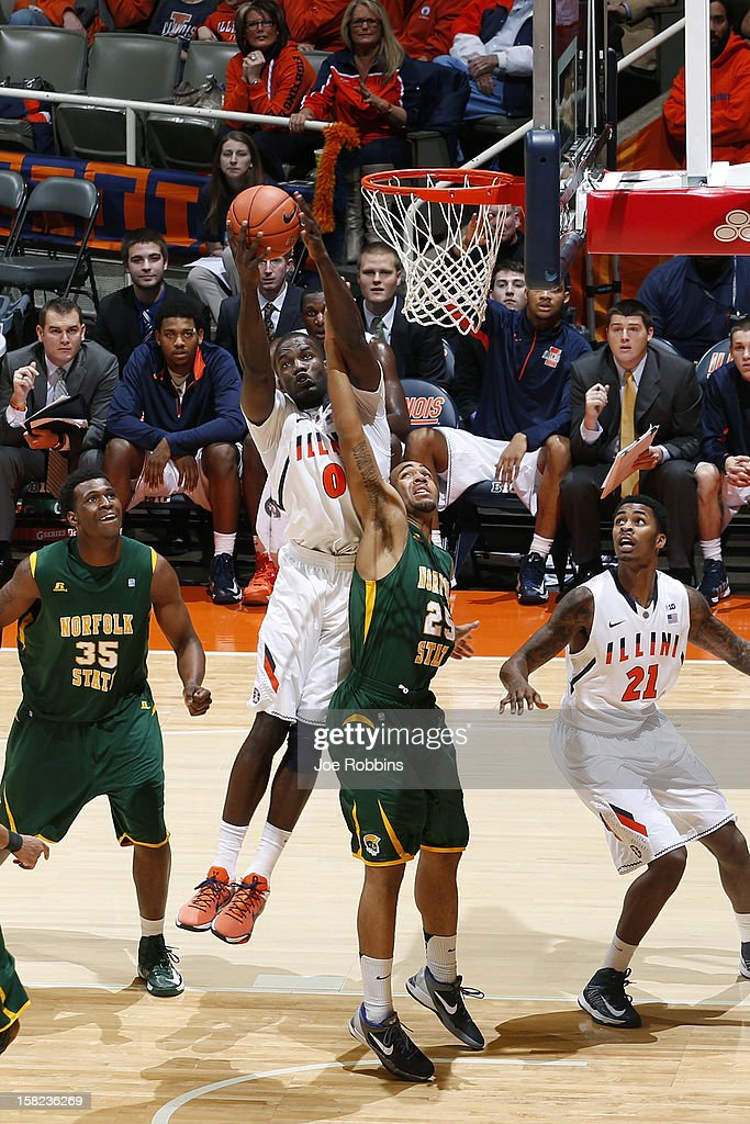 Sam McLaurin #0 of the Illinois Fighting Illini rebounds against Malcolm Hawkins #25 of the Norfolk State Spartans during the game at Assembly Hall on December 11, 2012 in Champaign, Illinois. Illinois won 64-54.