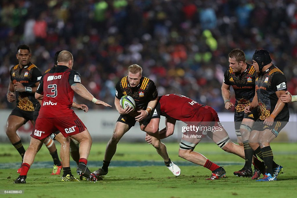 Sam McNicol of the Chiefs is tackled during the round 15 Super Rugby match between the Chiefs and the Crusaders at ANZ Stadium on July 1, 2016 in Suva, Fiji.