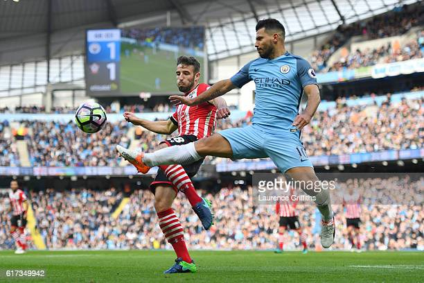 Sam McQueen of Southampton closes down Sergio Aguero of Manchester City during the Premier League match between Manchester City and Southampton at...