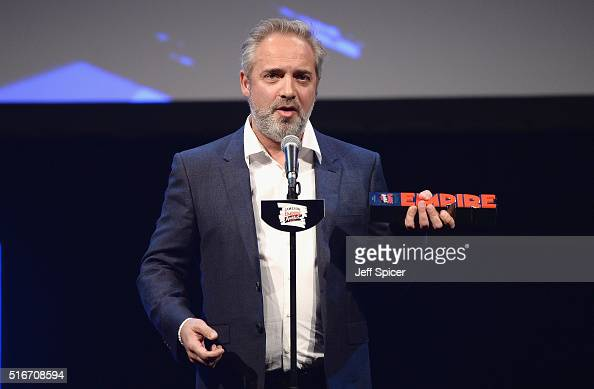 Sam Mendes accepts the award for Best British Film for Spectre on stage during the Jameson Empire Awards 2016 at The Grosvenor House Hotel on March...