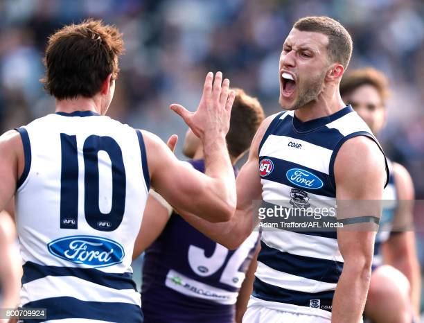 Sam Menegola of the Cats celebrates a goal with Daniel Menzel of the Cats during the 2017 AFL round 14 match between the Geelong Cats and the...