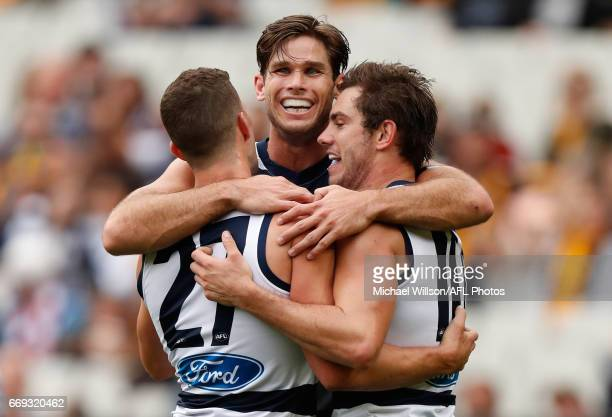 Sam Menegola Tom Hawkins and Daniel Menzel of the Cats celebrate during the 2017 AFL round 04 match between the Hawthorn Hawks and the Geelong Cats...