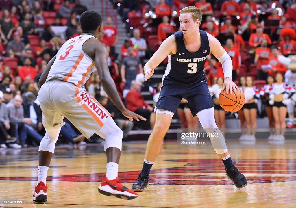 Sam Merrill #3 of the Utah State Aggies dribbles against Amauri Hardy #3 of the UNLV Rebels during their game at the Thomas & Mack Center on January 6, 2018 in Las Vegas, Nevada. Utah State won 85-78.