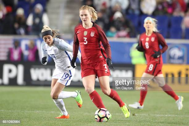 Sam Mewis of United States challenged by Toni Duggan of England during the USA Vs England SheBelieves Cup match at Red Bull Arena on March 4 2017 in...