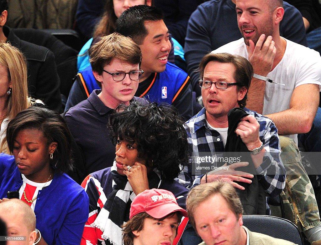 Sam Michael Fox and Michael J. Fox attend the Philadelphia 76ers vs