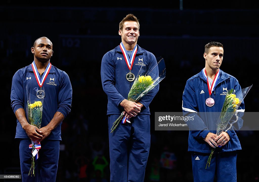 Sam Mikulak (center), <a gi-track='captionPersonalityLinkClicked' href=/galleries/search?phrase=John+Orozco&family=editorial&specificpeople=5084199 ng-click='$event.stopPropagation()'>John Orozco</a> (left), and <a gi-track='captionPersonalityLinkClicked' href=/galleries/search?phrase=Jacob+Dalton+-+Gymnast&family=editorial&specificpeople=12902966 ng-click='$event.stopPropagation()'>Jacob Dalton</a> (right) stand on the podium while accepting their medals in the senior men finals during the 2014 P&G Gymnastics Championships at Consol Energy Center on August 24, 2014 in Pittsburgh, Pennsylvania.