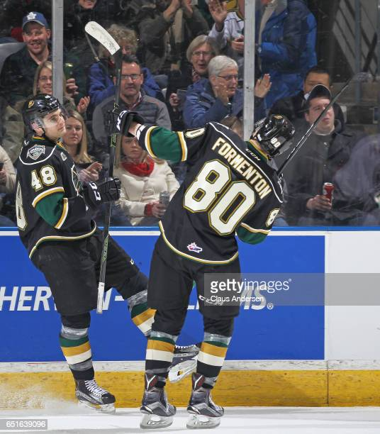 Sam Miletic of the London Knights celebrates a goal with teammate Alex Formenton against the Guelph Storm during an OHL game at Budweiser Gardens on...