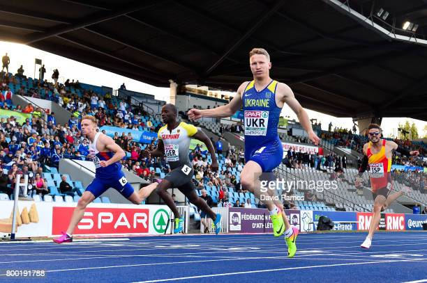 Sam Miller of Great Britain Aleixo Platini Menga of Germany Serhiy Smelyk of Ukraine and Oscar Husillos of Spain compete in the Men's 200m heat 1...