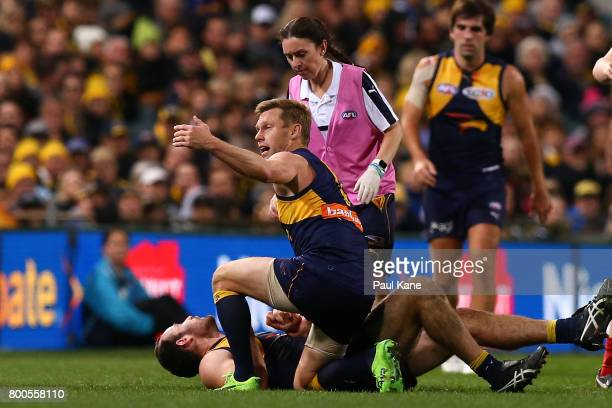 Sam Mitchell of the Eagles calls for trainers to assist Shannon Hurn during the round 14 AFL match between the West Coast Eagles and the Melbourne...