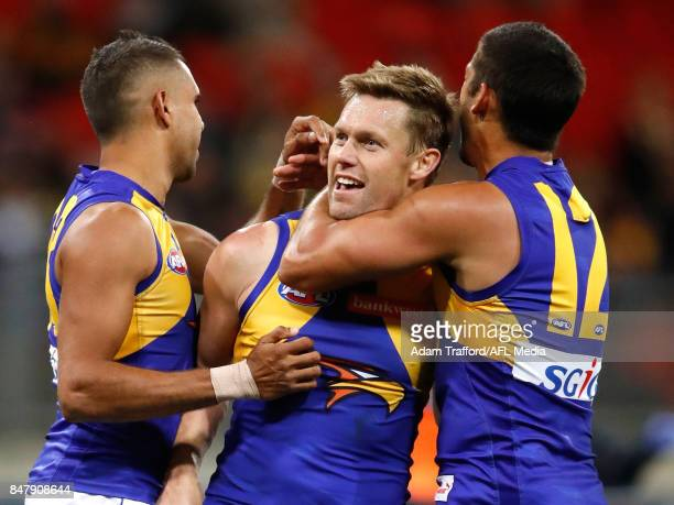 Sam Mitchell of the Eagles celebrates a goal with Lewis Jetta and Sharrod Wellingham of the Eagles during the 2017 AFL First Semi Final match between...