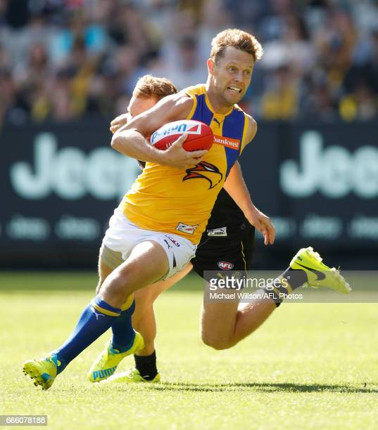 Sam Mitchell of the Eagles evades Nick Vlastuin of the Tigers during the 2017 AFL round 03 match between the Richmond Tigers and the West Coast...