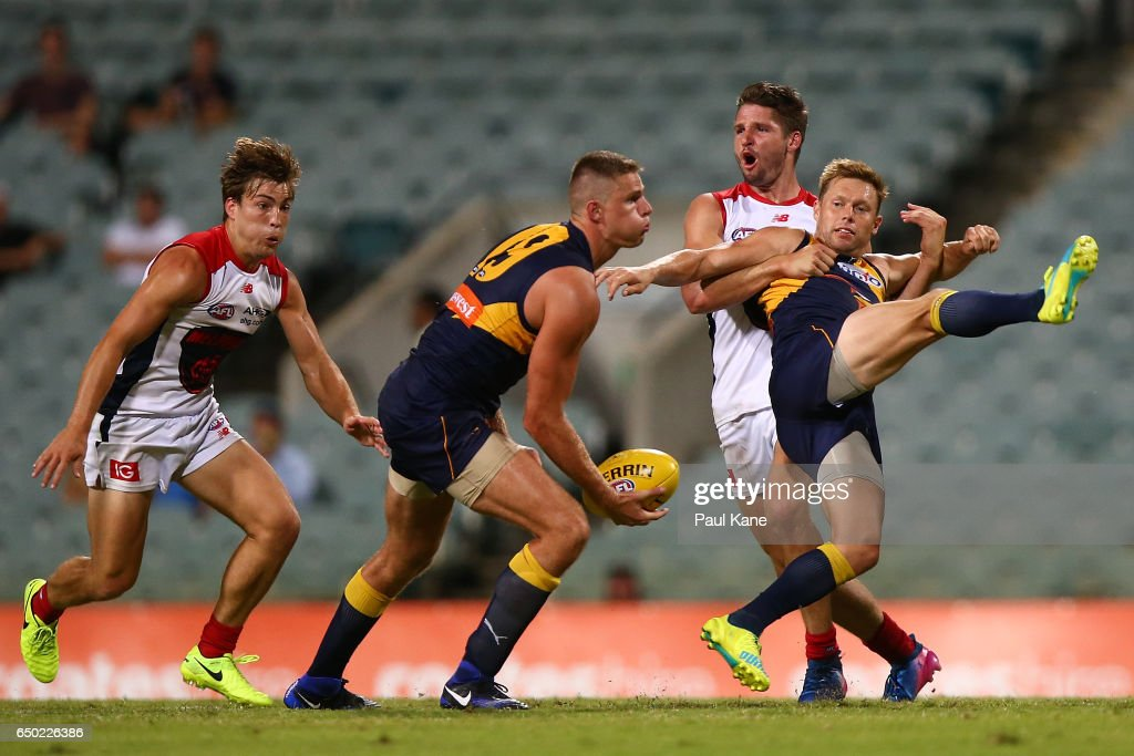 Sam Mitchell of the Eagles gets tackled by Jesse Hogan of the Demons during the JLT Community Series AFL match between the West Coast Eagles and the Melbourne Demons at Domain Stadium on March 9, 2017 in Perth, Australia.