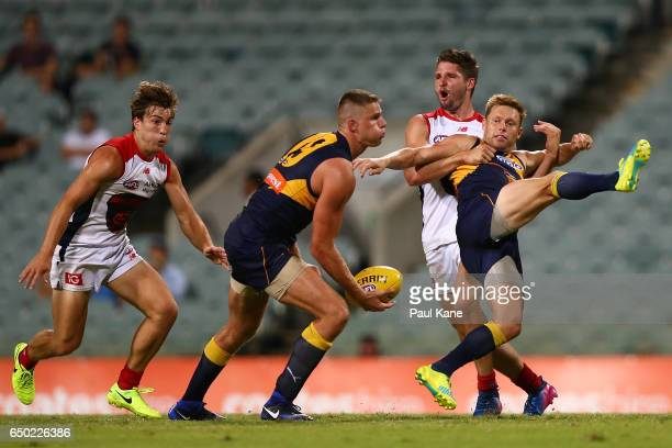 Sam Mitchell of the Eagles gets tackled by Jesse Hogan of the Demons during the JLT Community Series AFL match between the West Coast Eagles and the...