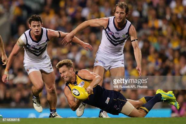 Sam Mitchell of the Eagles handballs during the round six AFL match between the West Coast Eagles and the Fremantle Dockers at Domain Stadium on...