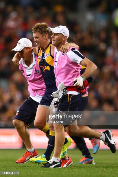 Sam Mitchell of the Eagles is assisted from the field with a lower leg injury during the round four AFL match between the West Coast Eagles and the...