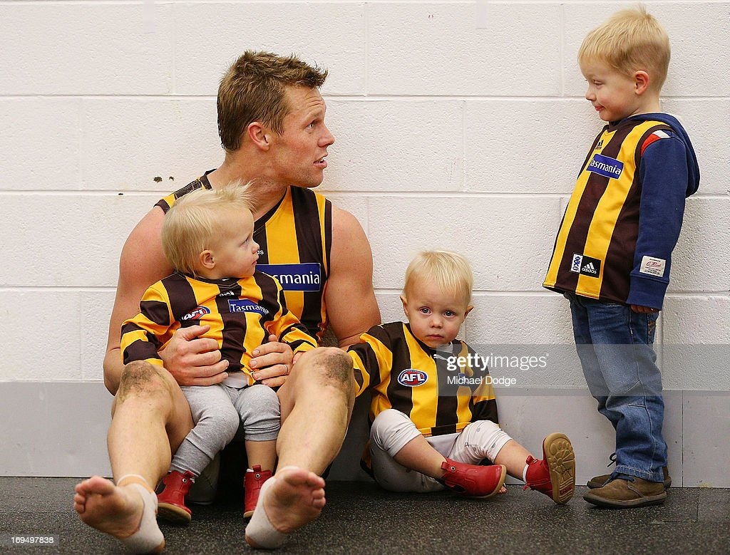 <a gi-track='captionPersonalityLinkClicked' href=/galleries/search?phrase=Sam+Mitchell+-+Australian+Rules+Football+Player&family=editorial&specificpeople=15086217 ng-click='$event.stopPropagation()'>Sam Mitchell</a> of the Hawks celebrates win with his twin daughters Emmerson Mitchell and Scarlett Mitchell and son Smith Mitchell (R) during the round nine AFL match between the Hawthorn Hawks and the Gold Coast Suns at Melbourne Cricket Ground on May 26, 2013 in Melbourne, Australia.