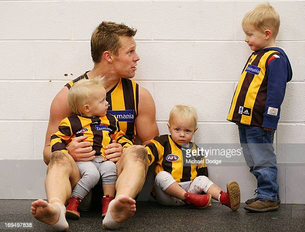 Sam Mitchell of the Hawks celebrates win with his twin daughters Emmerson Mitchell and Scarlett Mitchell and son Smith Mitchell during the round nine...