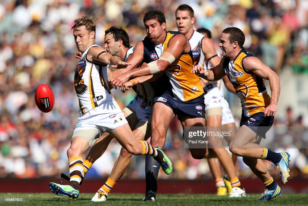 <a gi-track='captionPersonalityLinkClicked' href=/galleries/search?phrase=Sam+Mitchell+-+Australian+Rules+Football+Player&family=editorial&specificpeople=15086217 ng-click='$event.stopPropagation()'>Sam Mitchell</a> of the Hawks clears the ball from the center square during the round two AFL match between the West Coast Eagles and the Hawthorn Hawks at Patersons Stadium on April 7, 2013 in Perth, Australia.