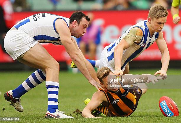 Sam Mitchell of the Hawks competes for the ball against Todd Goldstein of the Kangaroos and Jack Ziebell during the round 21 AFL match between the...