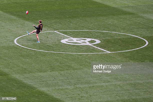 Sam Mitchell of the Hawks inspects the centre circle during the round one AFL match between the Geelong Cats and the Hawthorn Hawks at Melbourne...