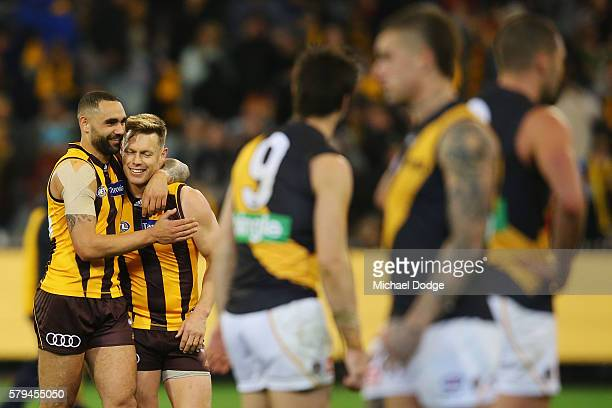 Sam Mitchell of the Hawks is hugged by Shaun Burgoyne after winning his 300th match during the round 18 AFL match between the Hawthorn Hawks and the...